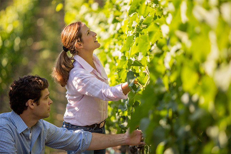 Bibiana and Jeff Inspecting Vines